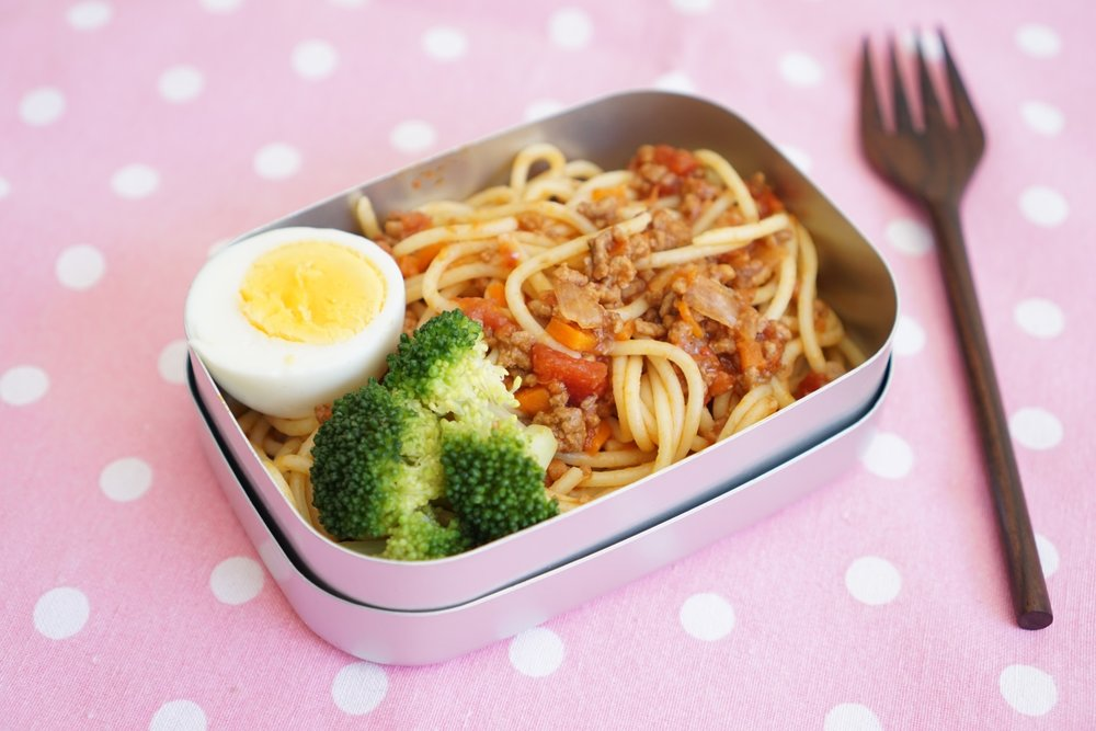 I made Pasta lunch for my daughter and served it in a  Hello Kitty aluminium lunch box.   This is her favorite lunch these days.  I want my children to eat a lot of vegetables but my daughter and younger son are both really fussy about food. I spoke with some friends about the best ways to hide vegetables in kids food.  We agreed spaghetti bolognese with many finely diced vegetables is one of the better ideas and both my kids love it!