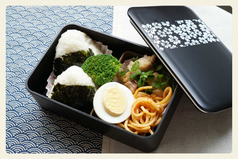 Most lunch containers in Australia are uninteresting...  This simple shaped, black color and cherry blossom panel create a modern atmosphere  This lunch was made with left overs! It doesnt look it does it?