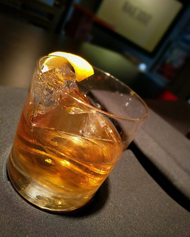 "It might be Joel's last night at Sidebar for a while, so come hang out! Tonight's Feature is an Old Fashioned style cocktail made with @michterswhiskey Sour Mash, @fewspirits Anguish and Regret, Creme de Peche, and Jerry Thomas Bitters, served over one large cube. Joel calls it, ""The Jabroni on The Rock."" #sidebargr #cocktails #michters #few #fewspirits #malort #peach #jerrythomas #therock #dwaynejohnson #canyousmellwhattherockiscooking #jabroni"