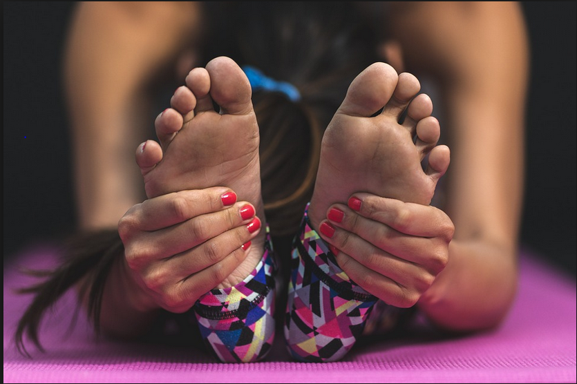 Bring your legs out in front of you and begin the exercise by slowly scrunching your toes then spreading them apart as far as you can. Perform this movement 5 times on each foot.