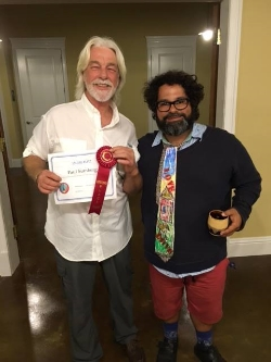 Town Artist, Bryant Martinez presents the Second Place Award to Paul Sumberg.