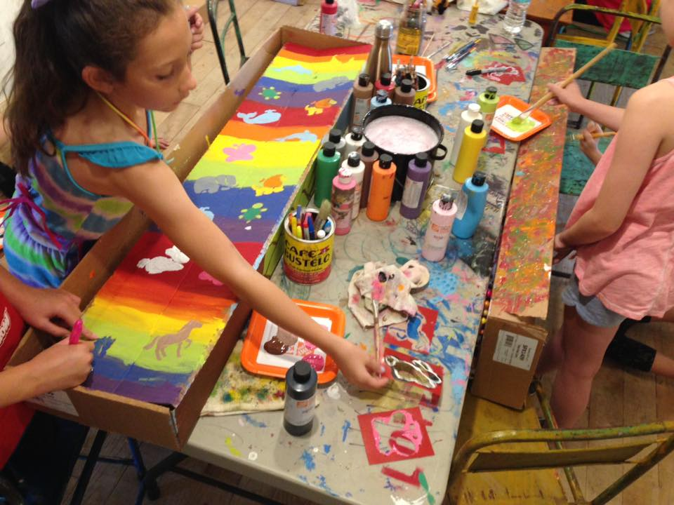 Art Factory kids painting in our gallery space.