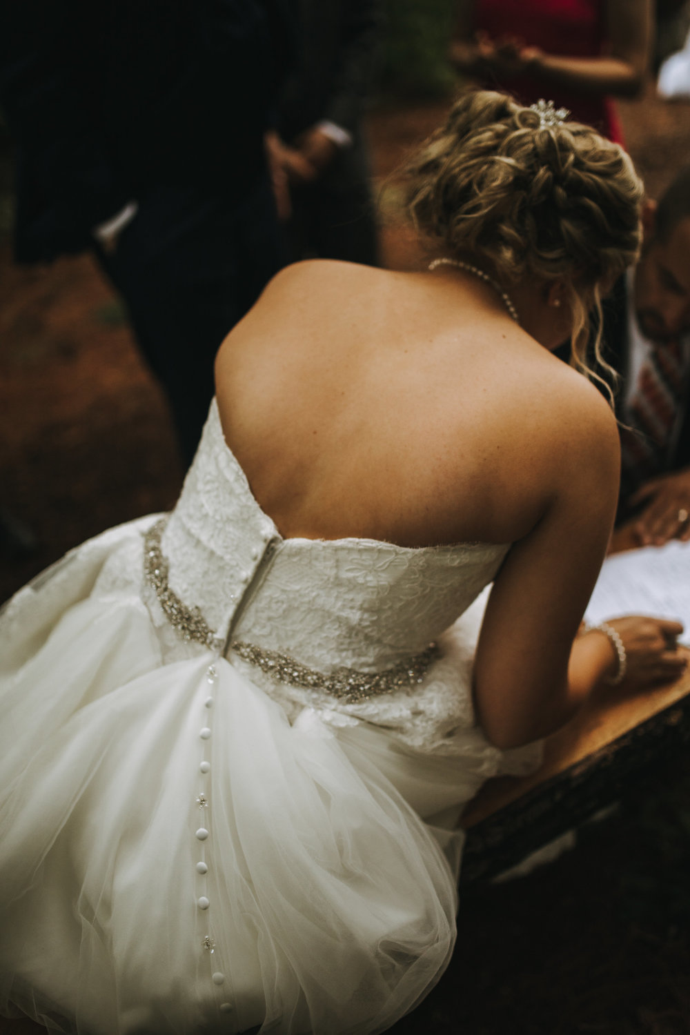 The details on Destinee's dress while she was signing the marriage license.