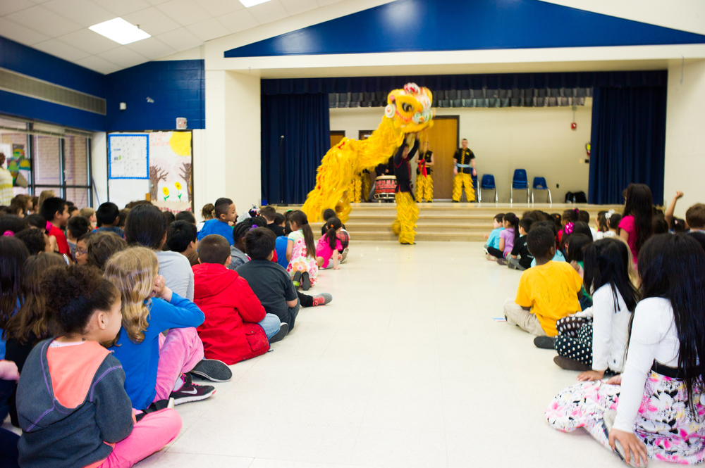The day began with a dramatic Lion Dance performance (by the  Tai Yim Kung Fu School)  for K-2 plus the morning PreK class.