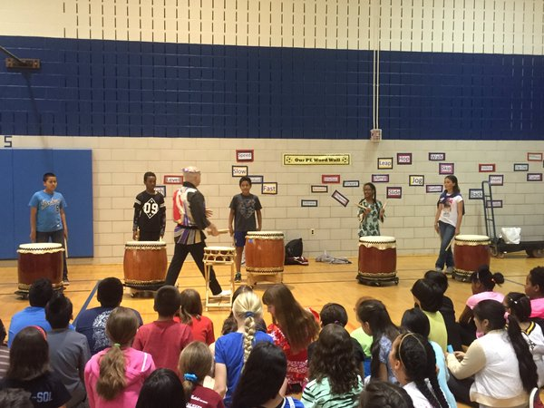 Mark H Rooney, taiko drummer,  demonstrated and then invited the students to perform.