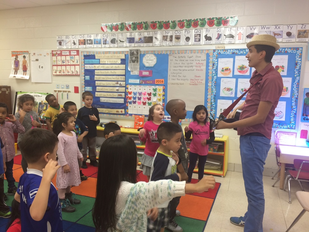 123 Andrés  worked with Head Start students before his performance with grades 3-5.