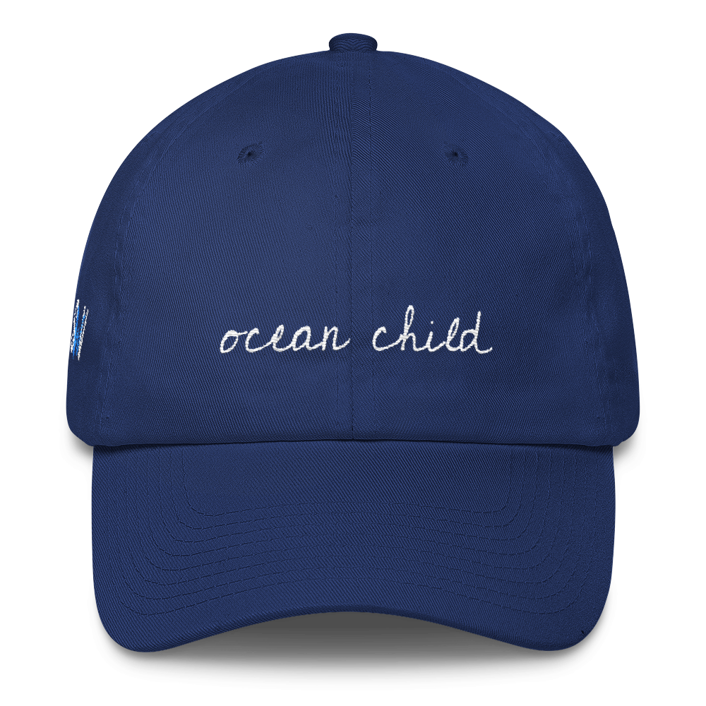 shop now - This stylish but simple 'Ocean Child' hat is an adjustable 6 panel soft crown hat. It is the perfect accessory to any outfit.