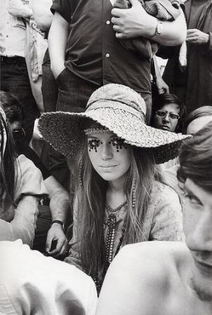 One of the most famous images from a late 60s festival featuring this woman with jewels around her eyes.