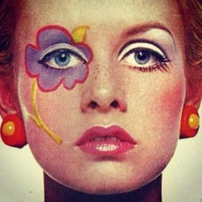 Twiggy with flower power face paint.