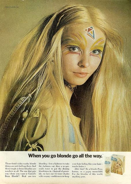 Hair dye advertisement featuring long hair and face paint as was popular at the time
