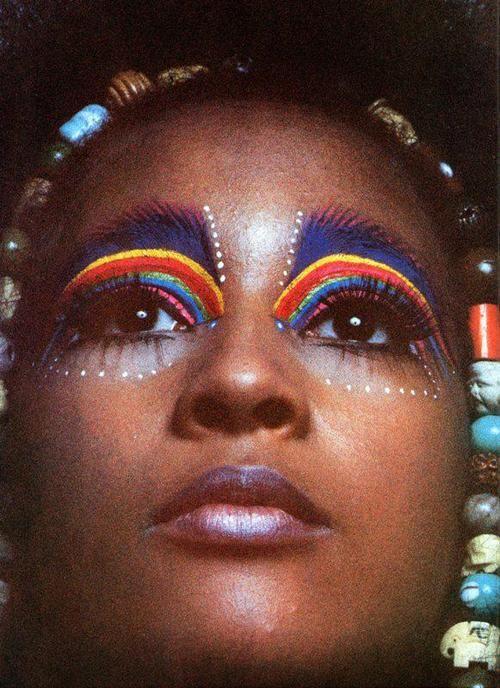 Rainbow design face paint looks striking
