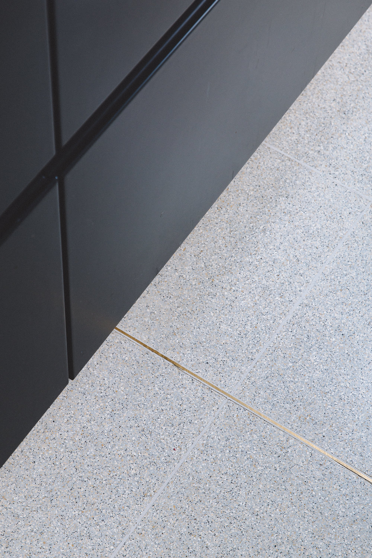 Terrazzo floor brass inlay