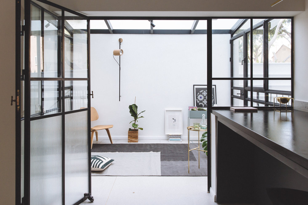 Patio. Glass and steel doors. Ferm living, eames chair. Weinbroom light
