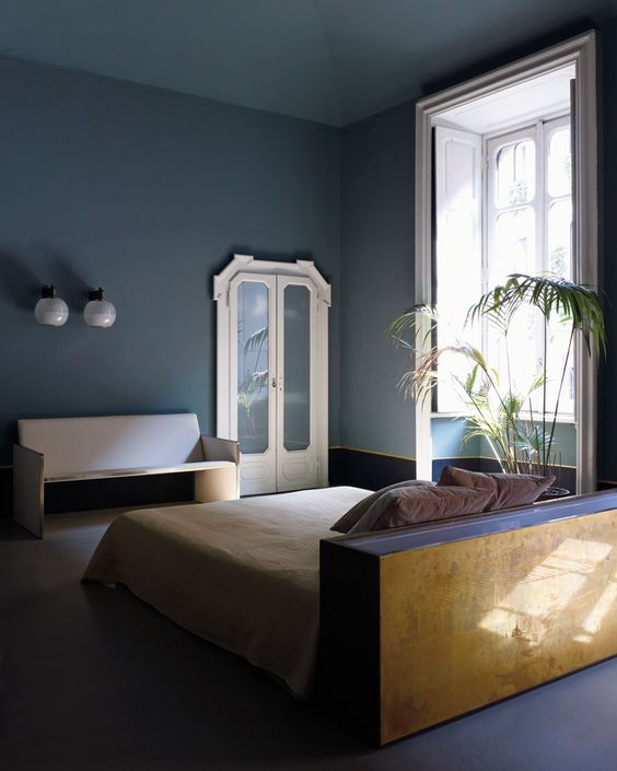Dimore studio bedroom in blue and brass