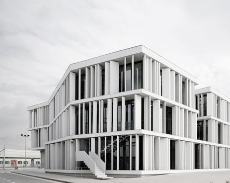 Vertical louvers in white on facade