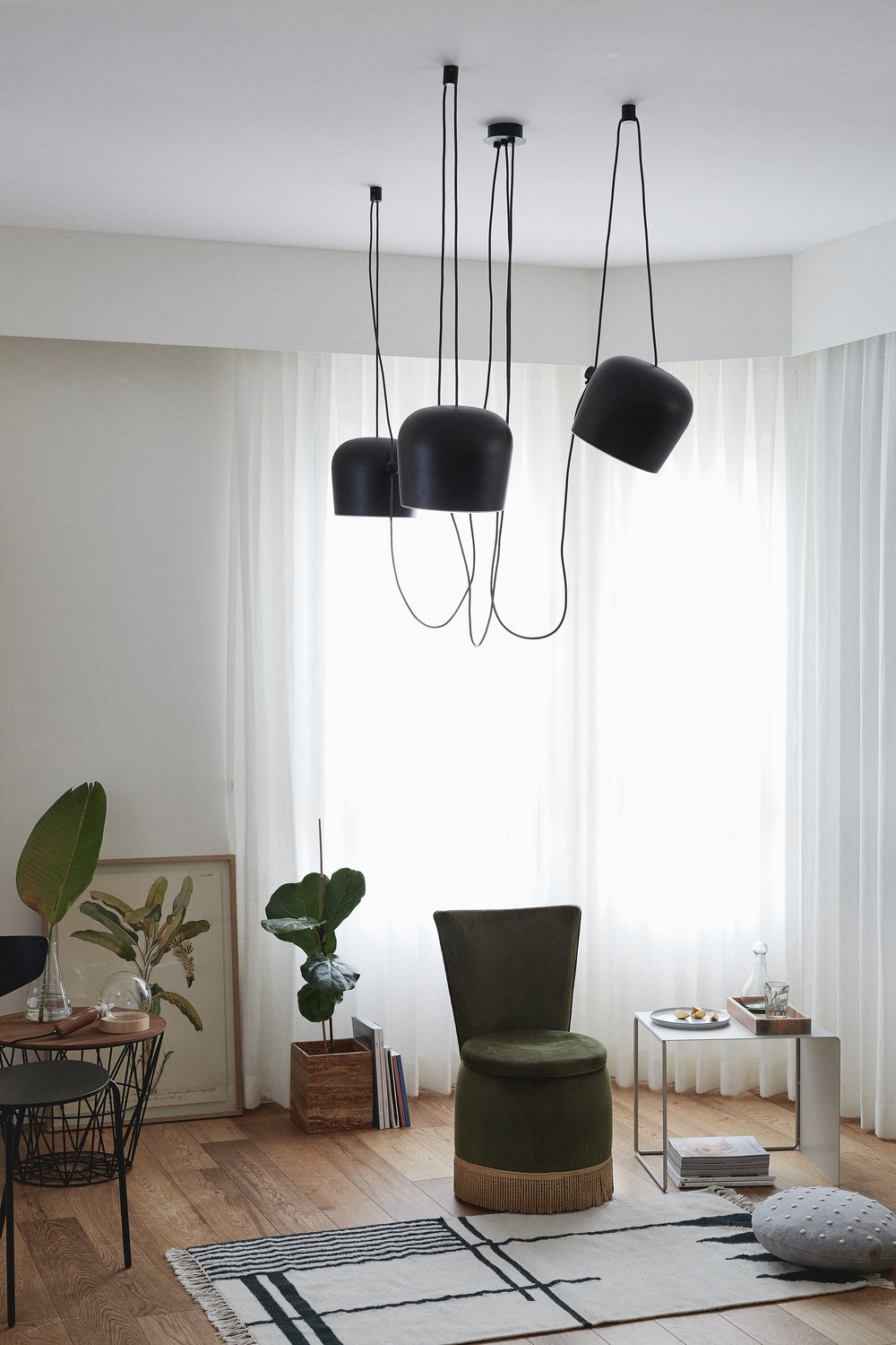 Flos lighting. green velvet chair. Ferm Living furniture