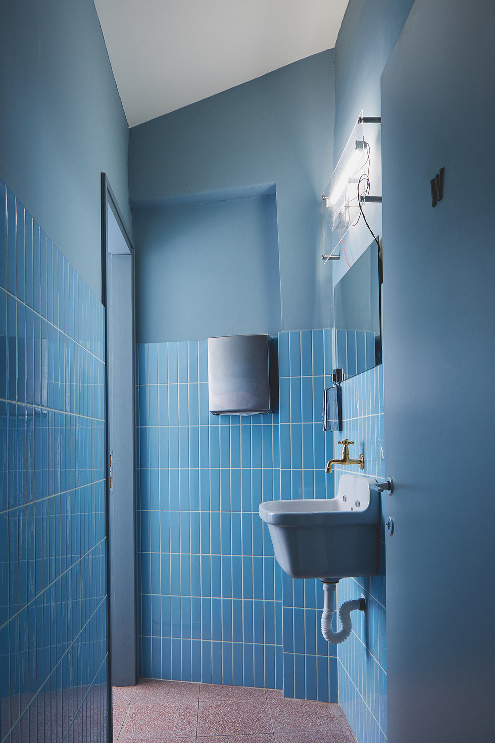 restaurants toilets with red terrazzo floor and light blue tiles
