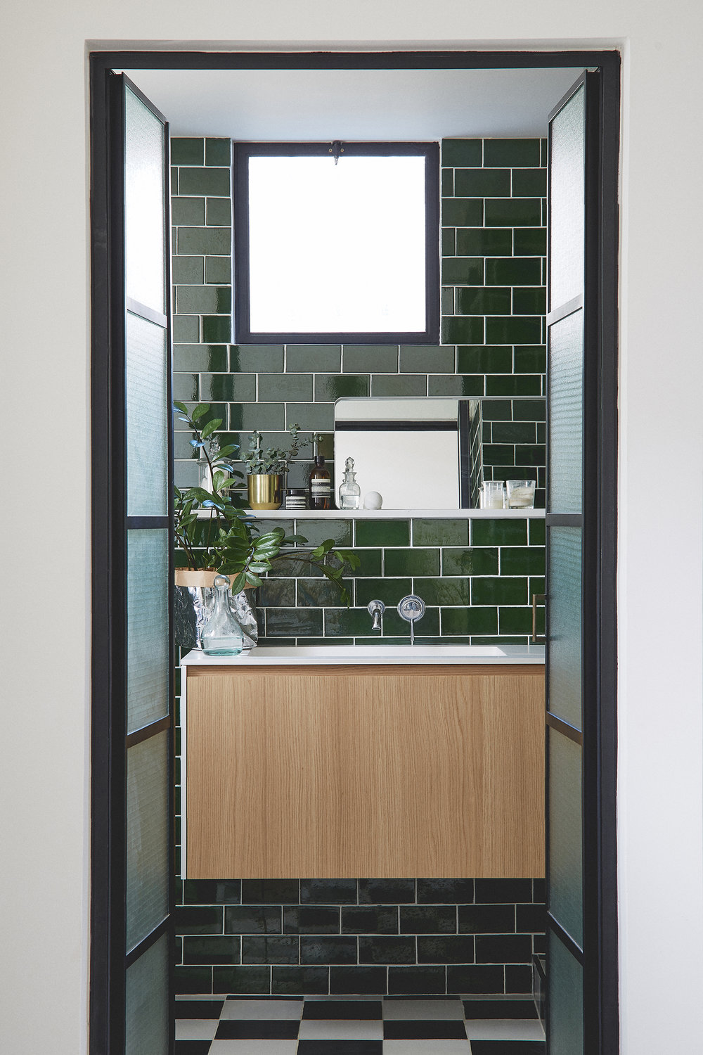 green subway tiles bathroom checkers-like floor, steel frame doors bathroom