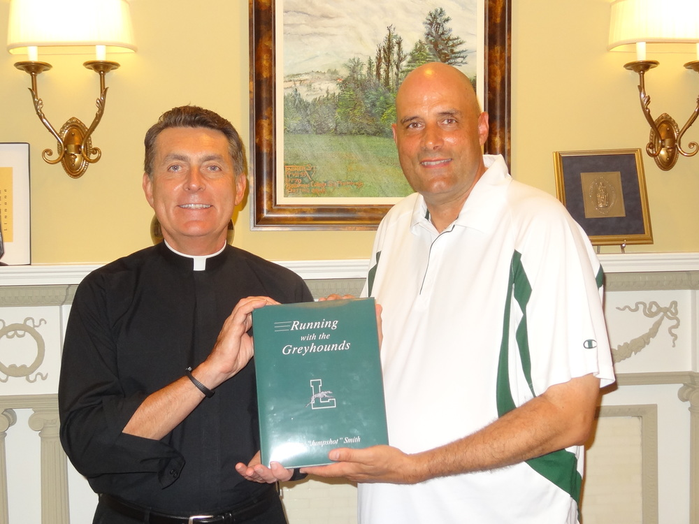 "Loyola University Maryland President Rev. Brian Linnane, S.J. with Jimmy ""Jumpshot"" Smith (Photo by Jimmy Smith)"