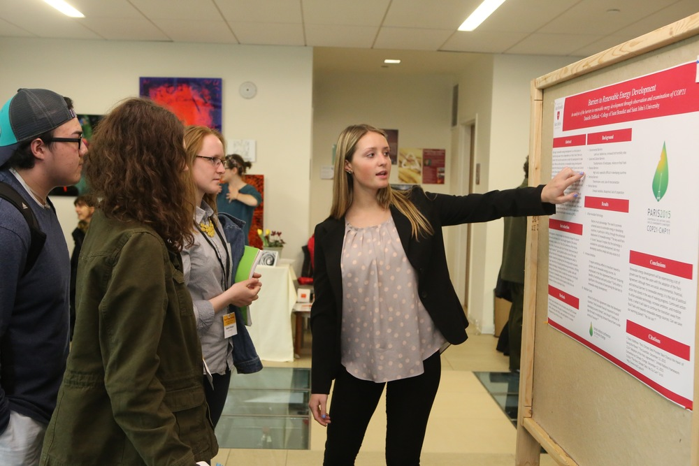 Students at a poster session during Loyola University Chicago's 2016 Climate Change Conference (Photo by Mark Beane)