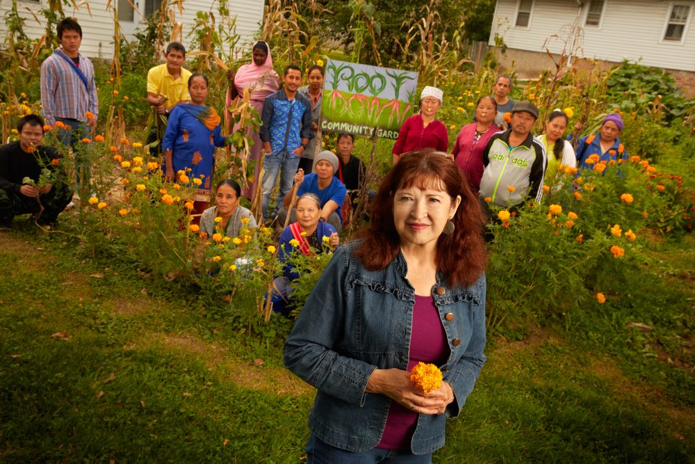 Barbara Dilly, Ph.D. (foreground), a professor in the Department of Cultural and Social Studies at Creighton University, is dedicated to community gardening. Root Down, one of two Bluejay Community Garden projects, is not only environmentally friendly, but connects Creighton to the community and refugees to each other and to their new home (Photo by Creighton University)