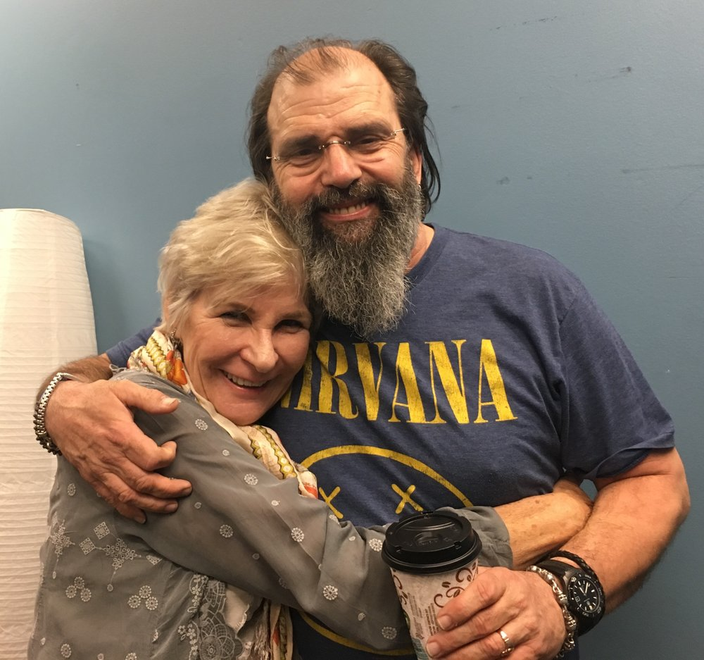 Gail Griffith, Director of JRS-USA's Global Education Initiative, with Steve Earle (Photo by Deanna Howes)