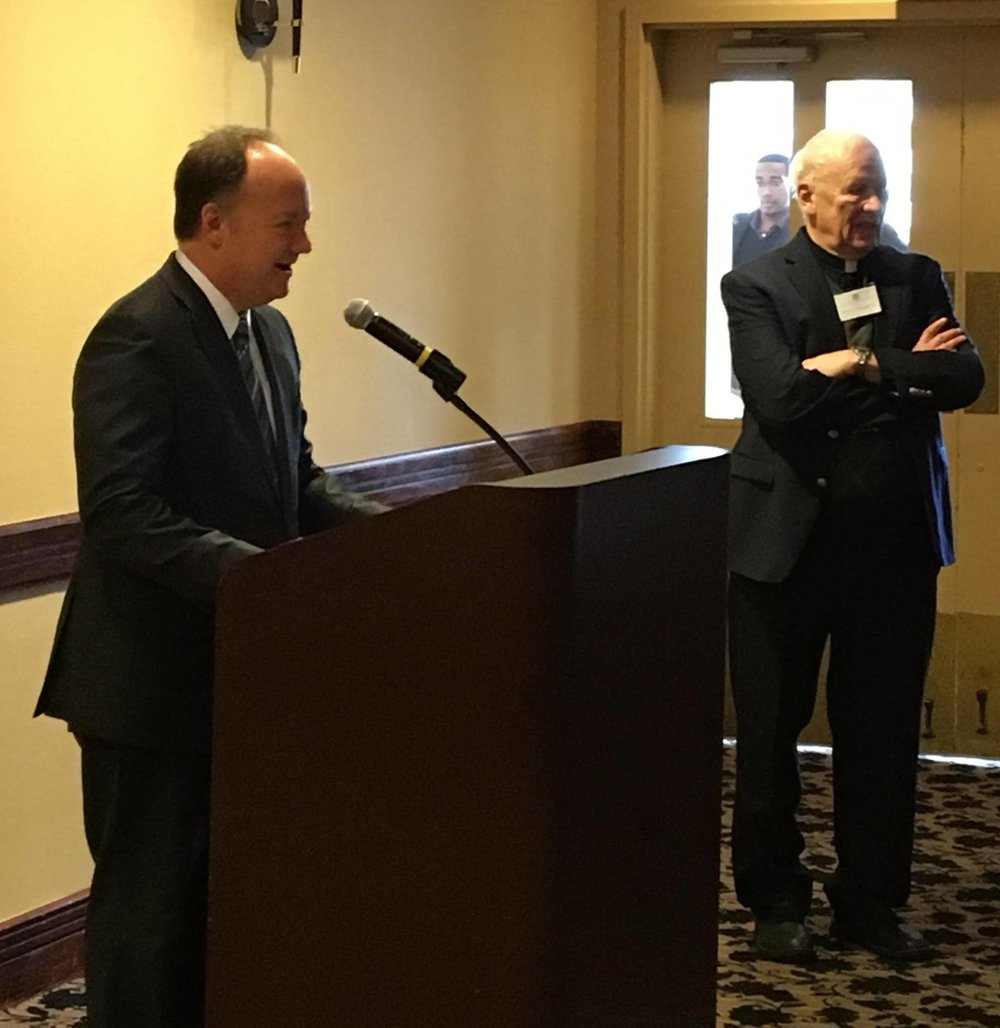 Georgetown University President Dr. John DeGioia greets members of the National Seminar on Jesuit Higher Education during their January 2017 meeting in Washington, D.C. (Photo by Rev. Patrick Howell, S.J., pictured right)