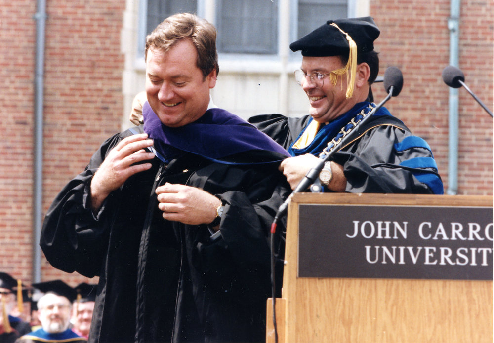 TIM RUSSERT RECEIVING AN HONORARY DEGREE FROM JOHN CARROLL UNIVERSITY IN 1997 (PHOTO BY JOHN CARROLL UNIVERSITY)