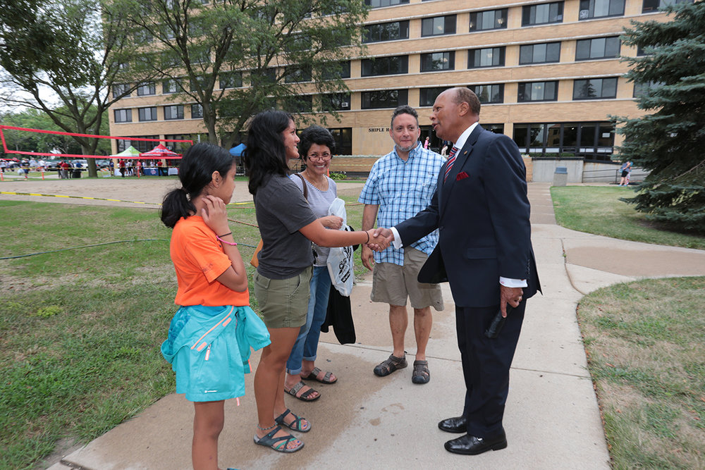 University of Detroit Mercy president Dr. Antoine M. Garibaldi greets a new student and her family on move-in day, Aug. 22 (Detroit, MI)