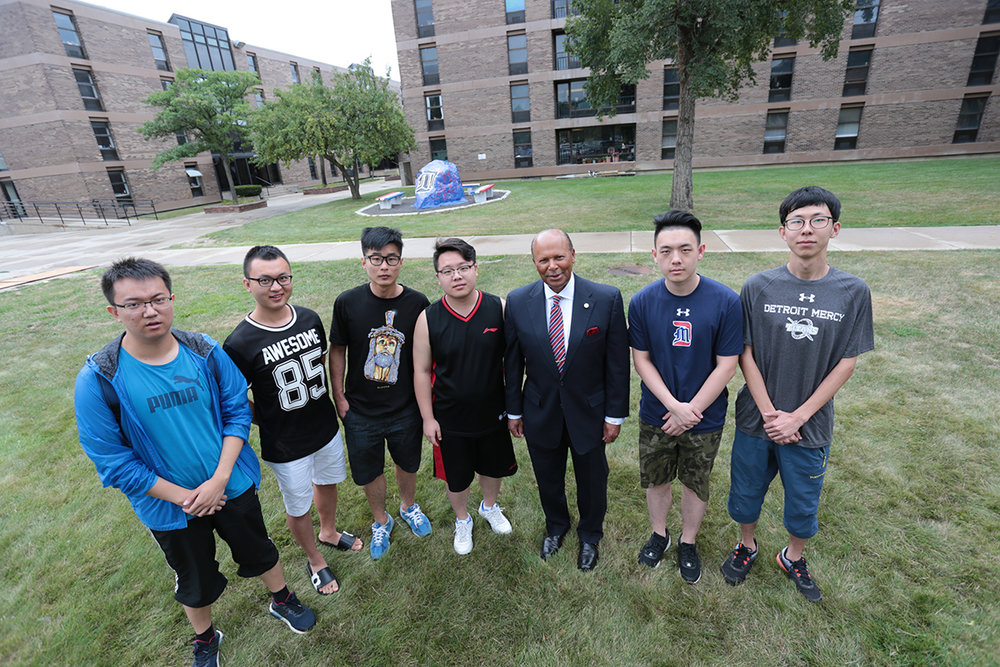 University of Detroit Mercy president Dr. Antoine M. Garibaldi (third from right) stands with a group of students from China who will study at Detroit Mercy this fall (Detroit, MI)