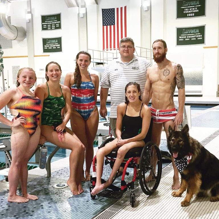 Five members of Team USA train together under Coach Brian Loeffler, '91, at the Mangione Aquatic Center at Loyola University Maryland: (pictured left to right) McKenzie Coan, '18, Cortney Jordan, M.A.T. '16, Elizabeth Smith, Loeffler, Alyssa Gialamas, '18, and Navy veteran Brad Snyder and his service dog, Gizzy (photo courtesy of Loyola Athletics).