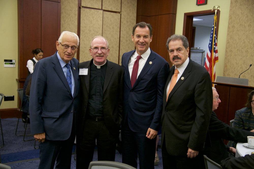 Representative William J. Pascrell, Jr. (D-NJ), Rev. Joseph M. McShane, S.J. (Fordham University), Representative Tom Suozzi (D-NY), Representative Jose Serrano (D-NY)