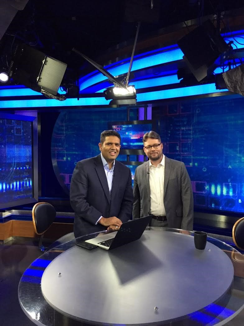 Jason Munshi-South with PBS' Hari Sreenivasan on the set of  SciTech Now  (Photo by Fordham University)