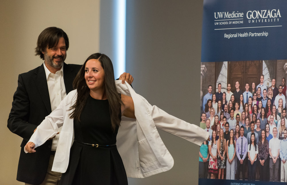 "A Gonzaga medical student receives her coat at the University's ""white coat"" ceremony"