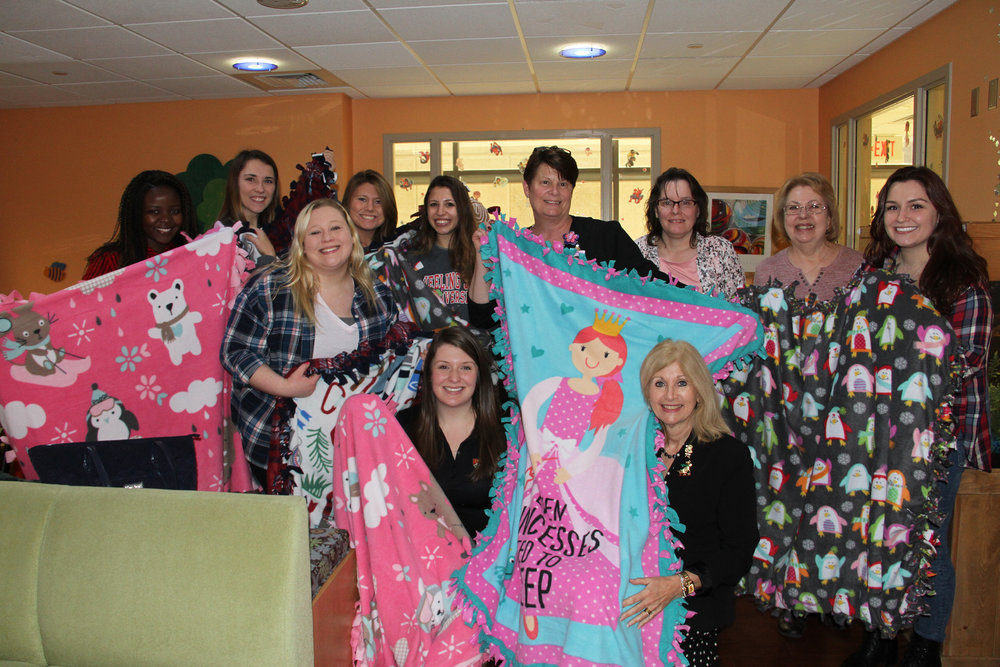 Wheeling Jesuit University nursing students made and delivered fleece blankets to Wheeling Hospital's pediatric department this Christmas season (photo by Wheeling Jesuit University)
