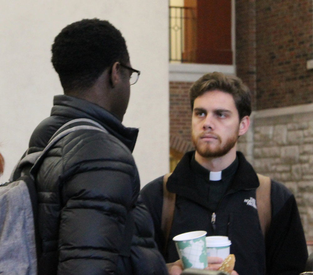 A young Jesuit on campus at Saint Louis University (photo by Saint Louis University)