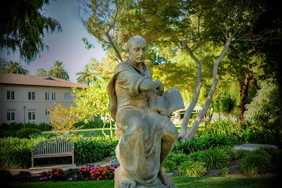 """The statue of St. Ignatius at Santa Clara is among the iconic sites on campus that students say extend their feeling of being valued and shaped as """"whole people"""" (photo by Joanne Lee, courtesy of Santa Clara University)"""
