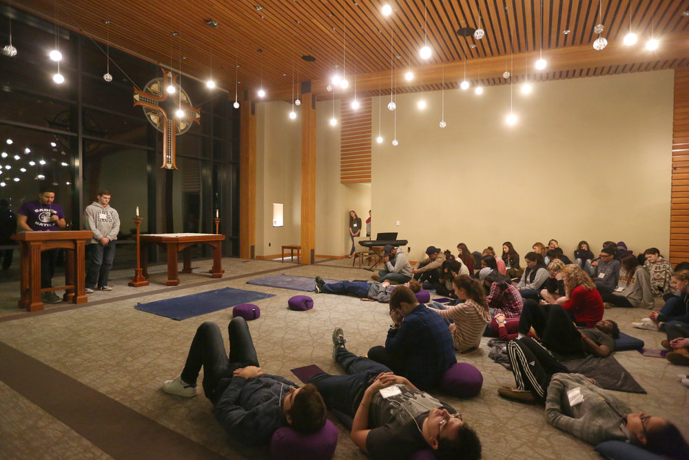 Students at prayer inside of the Contemplative Center (photo by Tom Retigg for the College of the Holy Cross)
