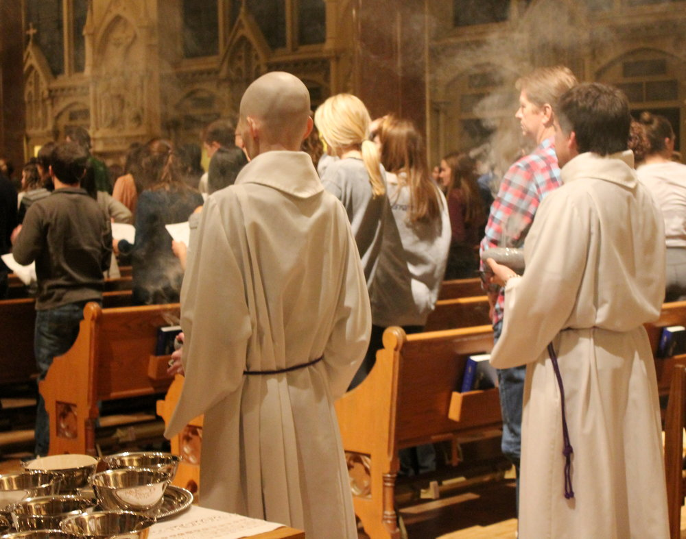 Students pray together at the 9 PM College Church Mass (photo by Molly Daily for Saint Louis University)