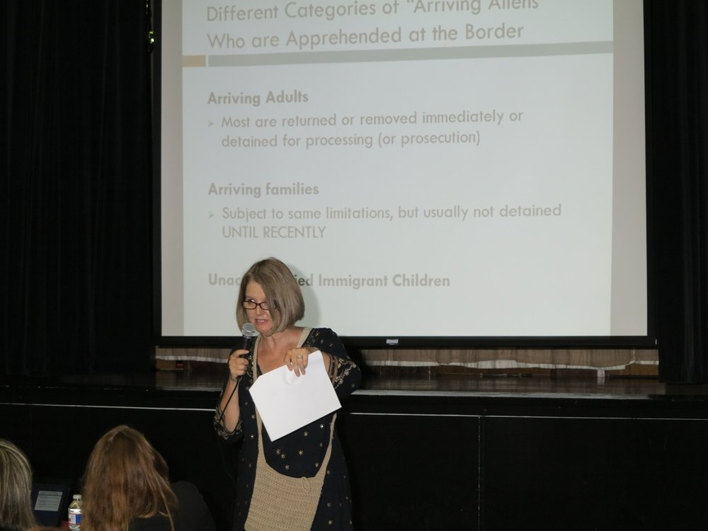 Susan Weishar, Ph.D. addresses a Catholic Teach-in on Migration at St. Anthony of Padua Church in New Orleans during the height of the child migration crisis in August 2014 (photo by S. Weishar)