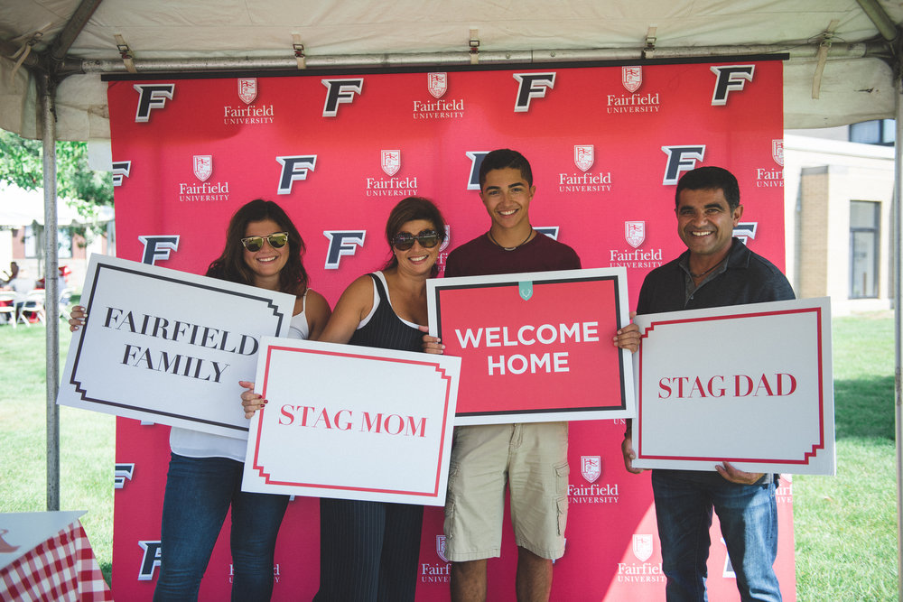 A Fairfield University family prepares for the next generation of Stag grads at move-in day last month (photo by Cassidy Kristiansen for Fairfield University)