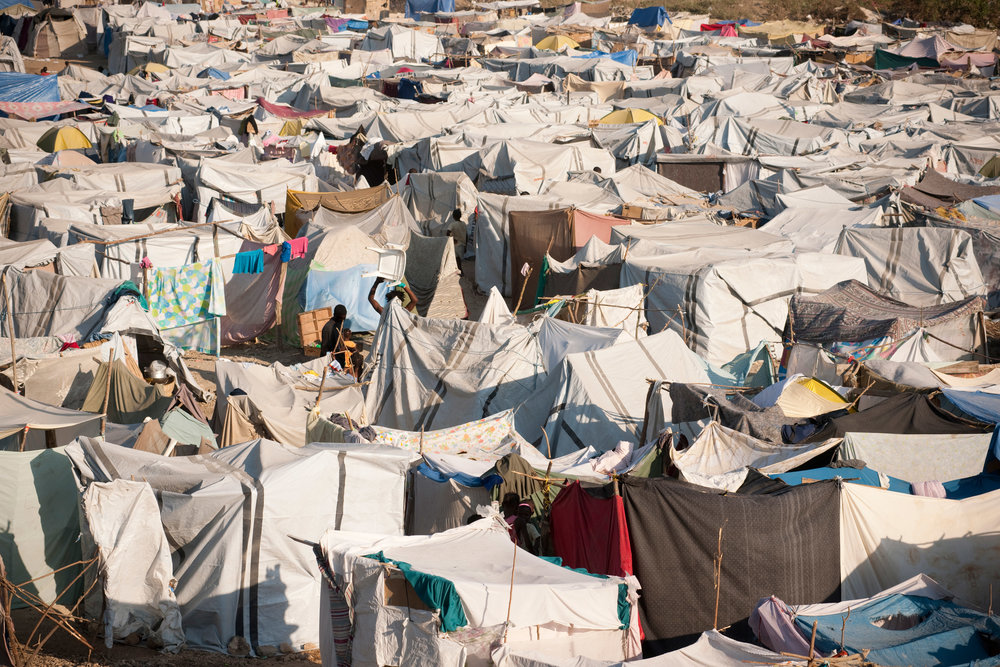 Tens of thousands of Haitians spent years living in tent cities following the 2010 earthquake (photo by Getty Images, courtesy of Loyola University Chicago)
