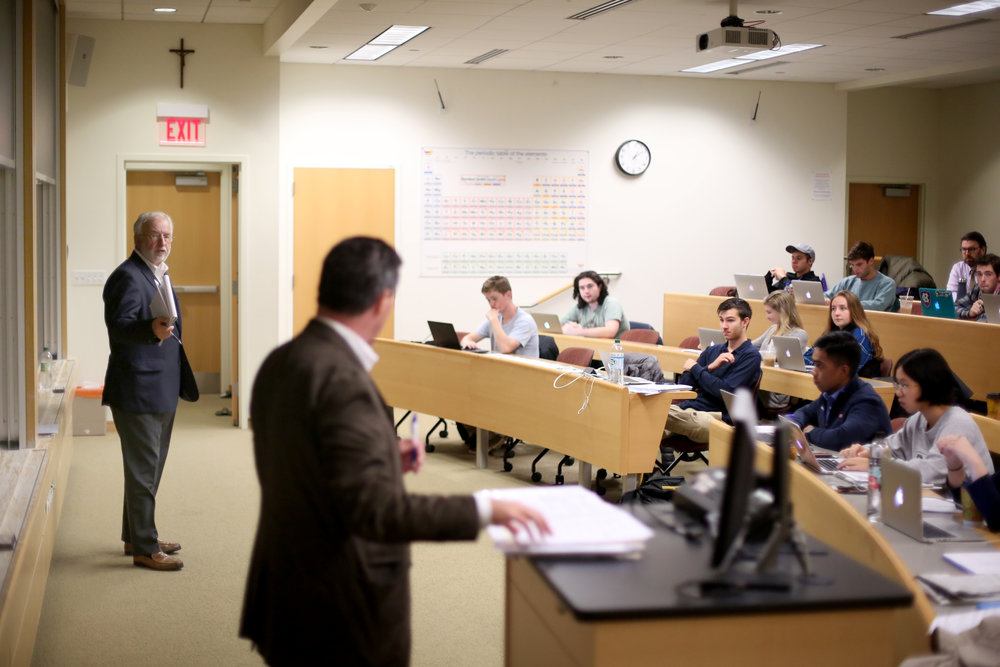 Tim Bishop (left) and Peter Flaherty lecture together during a recent class at the College of the Holy Cross (photo courtesy of John Hill, College of the Holy Cross)