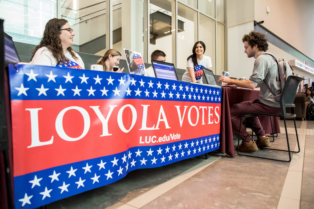Loyola University Chicago senior Will Gaudet (right) registers to vote in the Damen Student Center on September 25 as part of a National Voter Registration Day drive. In advance of the 2018 midterm elections, Loyola helped nearly 800 students register to vote through registration events on campus. (Photo: Lukas Keapproth)