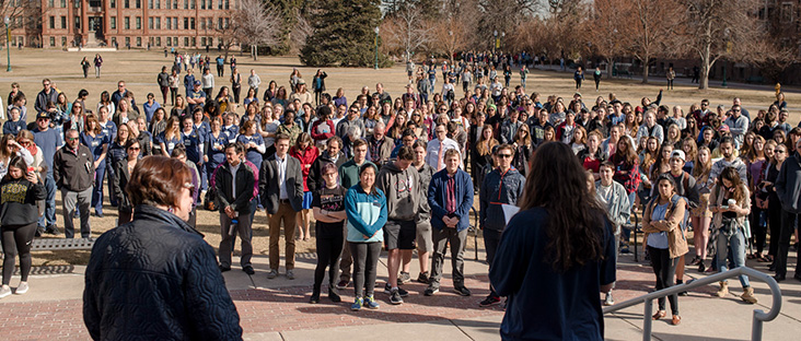 Regis University Freshman Yael Greene stood before a crowd of nearly 400 students, faculty and staff to honor the victims of the Parkland, FL shooting in 2018 (photo courtesy of Regis University)