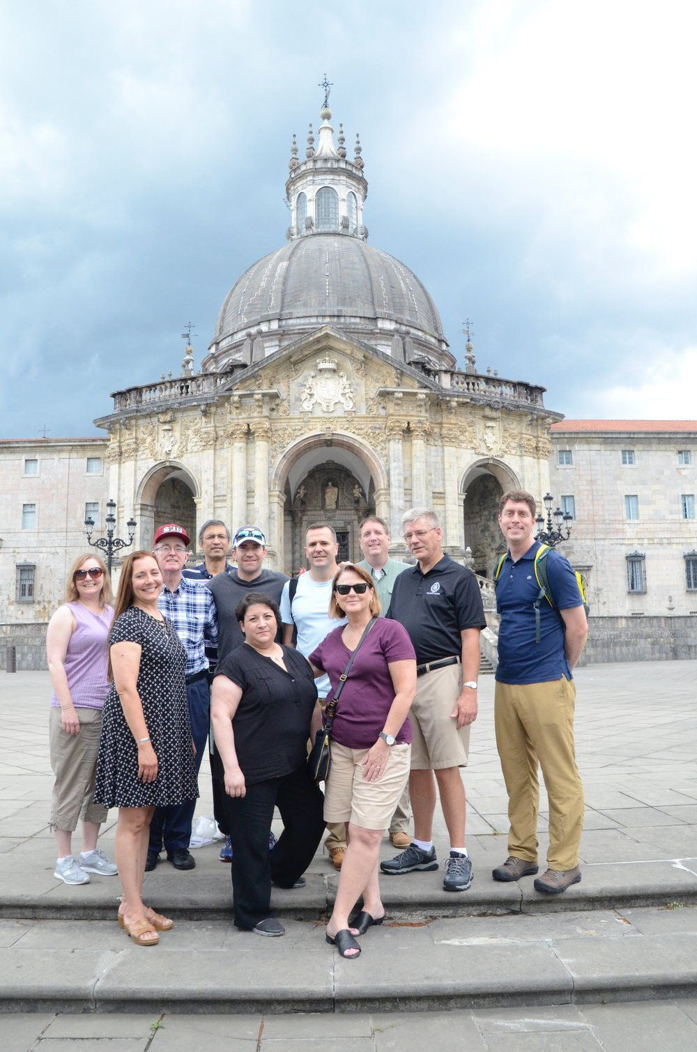 University of Scranton staff and faculty in front of the ancestral home of St. Ignatius (photo by University of Scranton)