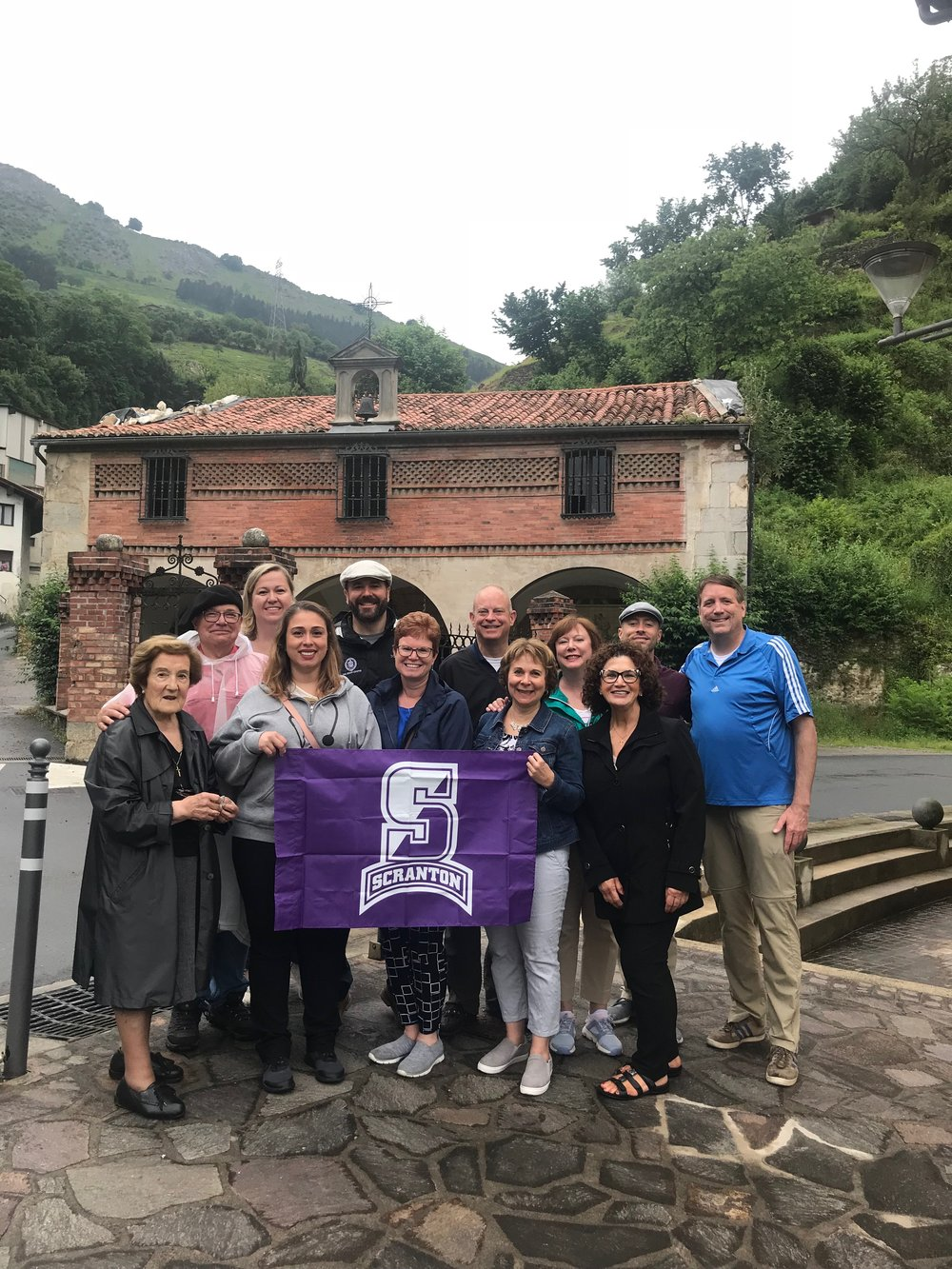University of Scranton staff and faculty at the chapel and hospital on the outskirts of Azpetia where Ignatius lived and worked with the poor (photo by University of Scranton)