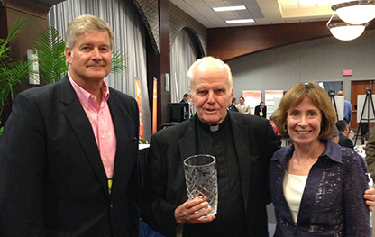 Fr. Currie received the Reverend J. Barry McGannon, S.J., Award from the Jesuit Advancement Administrators Conference at Xavier University in 2013 (pictured are Gary Massa, Vice President for University Relations at Xavier and Mary Kay McFadden, former Vice President for University Advancement at Seattle University)