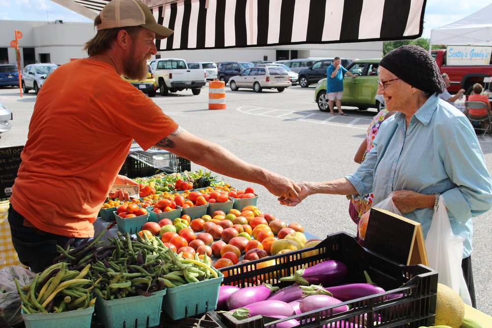 The Govanstowne Farmer's Market, a Loyola University Maryland program, is a hub of activity on Wednesdays during the summer (photo by Loyola University Maryland)