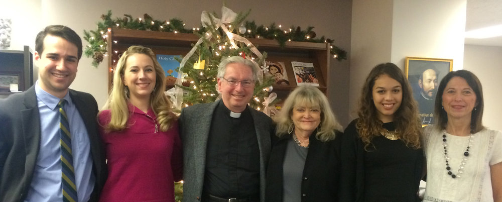 AJCU staff past and present (Christmas 2014): Patrick Nolan, Deanna Howes Spiro, Rev. Michael J. Sheeran, S.J., Cyndy Littlefield, Karen Larios and Brenda Hebert